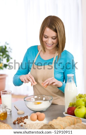 Baking - Smiling woman with healthy ingredients prepare organic dough - stock photo