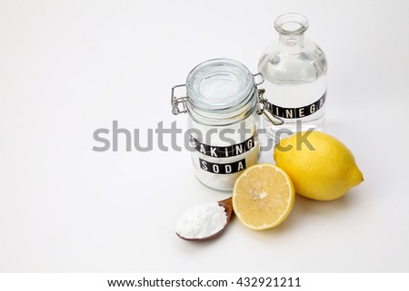baking soda vinegar and lemon on the white background - stock photo