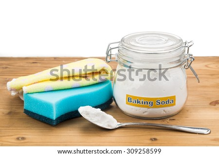 Baking soda with sponge and towel for effective and safe house cleaning - stock photo