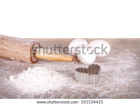 Baking still life, flour, eggs and rolling pin on an isolated white background - stock photo