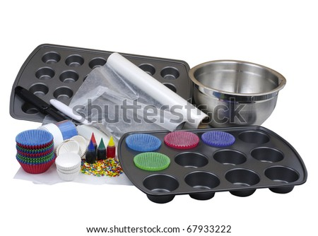 Baking supplies for cupcakes isolated on white - stock photo