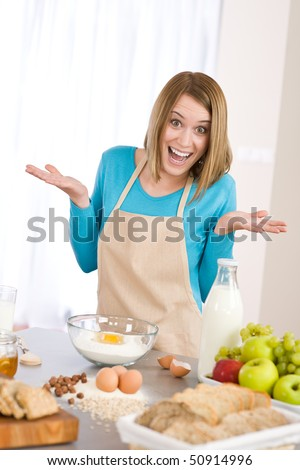 Baking - Surprised woman prepare fresh ingredients for healthy cake dough
