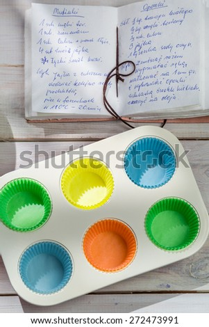 Baking sweet cupcakes with blueberries - stock photo