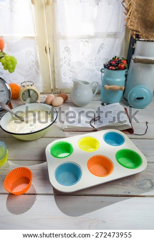 Baking tasty cupcakes with berry fruits - stock photo