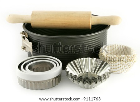 baking tin, and other equipment on white background - stock photo