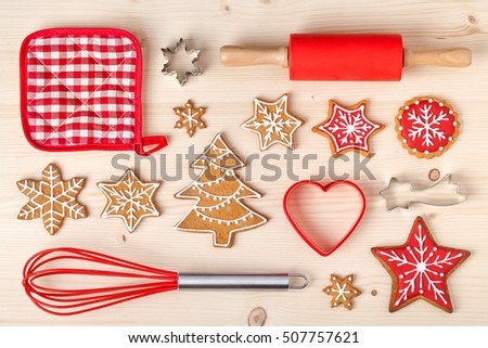 baking tools and christmas homemade gingerbread cookies on wooden background. snowflake, star, christmas tree shapes. holiday, celebration and cooking concept. new year and christmas postcard