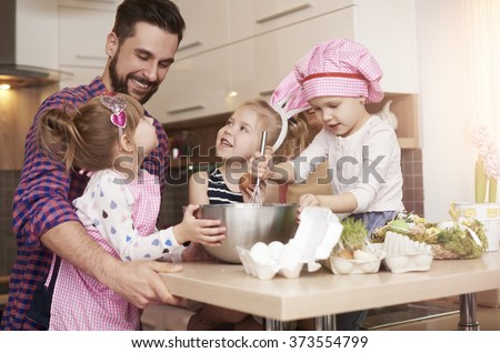 Baking with daughters for Easter time  - stock photo