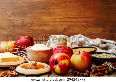 baking wood background with apples, nuts, honey, flour and butter. the toning. selective focus - stock photo