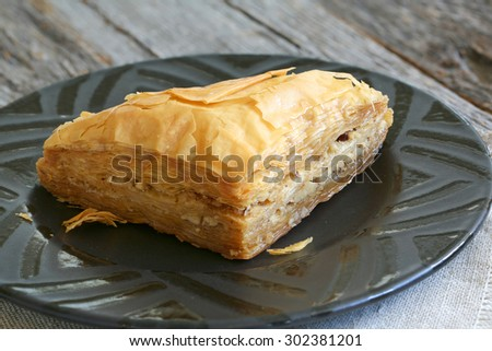Baklava, delicious pastry dessert made with phyllo dough, nuts, butter and sugar served on a plate - stock photo