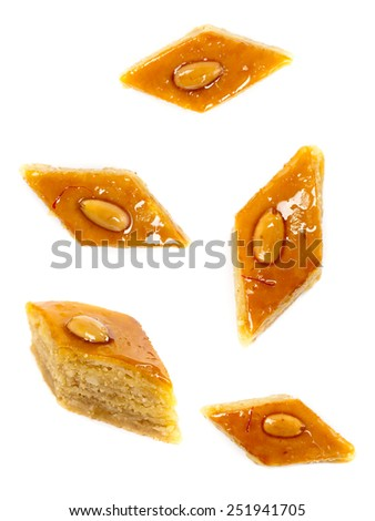 Baklava with almonds on white background. Selective focus. - stock photo