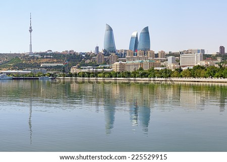 BAKU, AZERBAIJAN - AUGUST 23, 2014: View of Flame Towers skyscrapers and TV tower from Caspian Sea. Flame Towers, opened in 2013, is the tallest skyscrapers in Baku with a height of 190 m (620 ft). - stock photo