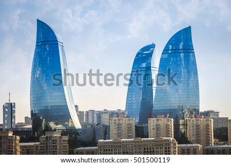 BAKU, AZERBAIJAN - JULY 9, 2016: View of Flame Towers from seafront near Milli Park. Flame Towers - the highest building in Azerbaijan located in Baku. Highest building Baku Flame tower. Tower flame