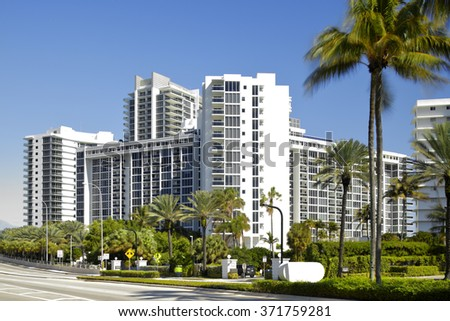 BAL HARBOUR - FEBRUARY 2: Stock image of the Ritz Carlton which is a luxury resort chain located at 10295 Collins Ave shot from across Collins Avenue February 2, 2016 in Bal Harbour FL, USA - stock photo