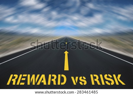 balance between risk and reward - stock photo