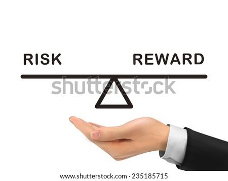 balance between risk and reward holding by realistic hand over white background - stock photo