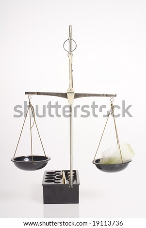 balance scale with feather - stock photo