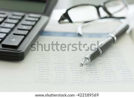 Balance sheet ,pen, calculator on accountant's desk. Accounting , bookkeeping concept. - stock photo