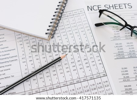 Balance sheet ,pencil, notebook ,glasses on accountant's desk. Accounting , accounts concept. - stock photo