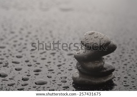Balance stones with water drops, close up
