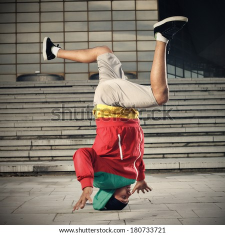 Balance stunt in an urban environment with motion effect - stock photo