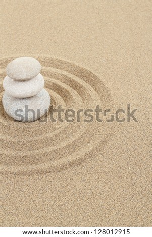 balance zen stones in soft sand with circles