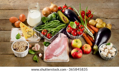 Balanced diet, cooking and organic food concept on rustic wooden table. Top view - stock photo