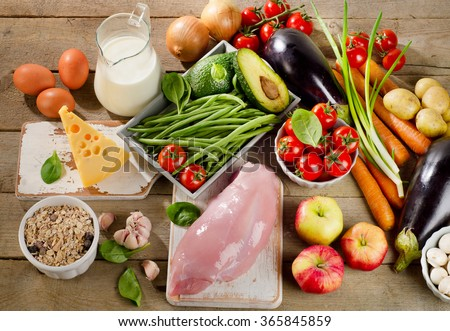 Balanced diet, cooking and organic food concept on rustic wooden table. View from above - stock photo