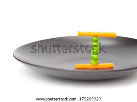 balanced diet food concept using peas and carrots on a plate - stock photo