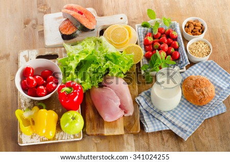Balanced diet, healthy food concept on wooden board. View from above - stock photo