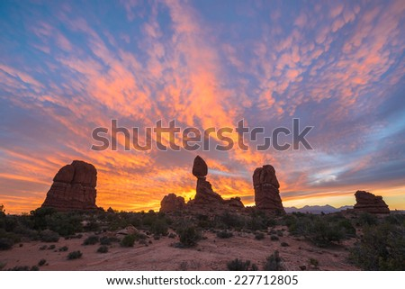 Balanced Rock at sunrise, Arches National Park, Utah, USA - stock photo