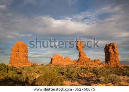 Balanced Rock in Arches National Park during sunset hours.