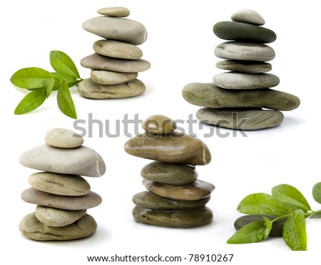 balanced spa stones with green plant isolated on white background - stock photo