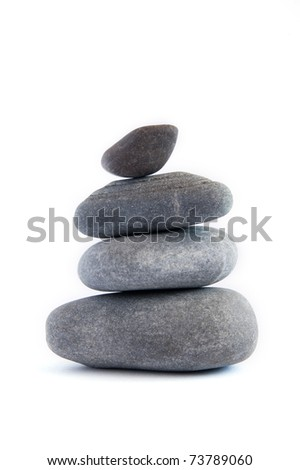 Balanced stack of stones isolated on white. Zen design concept.