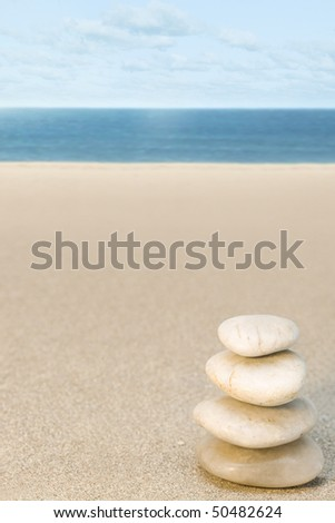 Balanced stone on beach sand