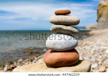 balanced stone pyramid of pebble on sea