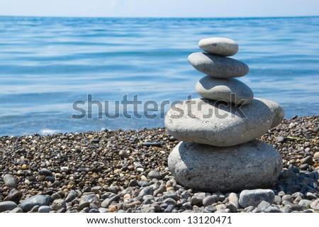 balanced stones on a beach - stock photo