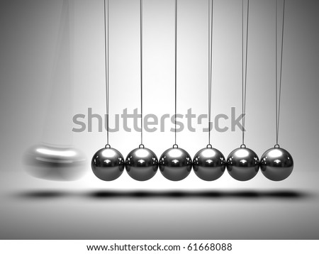 Balancing balls Newton's cradle on grey background - stock photo