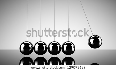 Balancing balls newtons cradle over dark background - stock photo