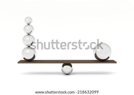 Balancing balls on wooden board - stock photo