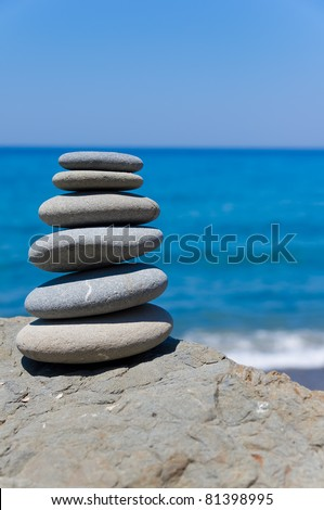 Balancing beach stones - stock photo