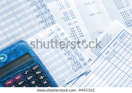 Balancing checkbook and bank statement. - stock photo