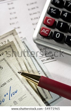 Balancing checkbook. Close up of checks,pen and calculator.