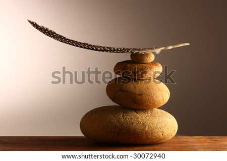 Balancing feather clear - stock photo