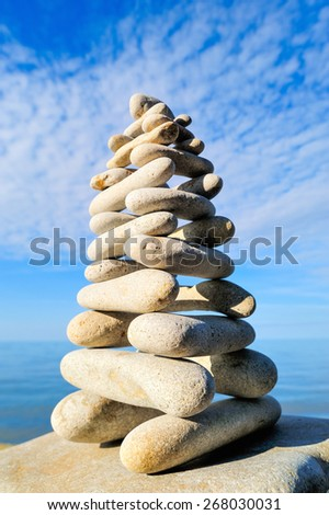 Balancing of stones each other on the seashore - stock photo