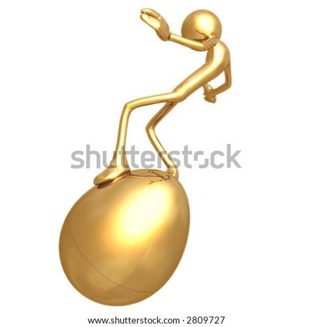 Balancing On Gold Nest Egg - stock photo