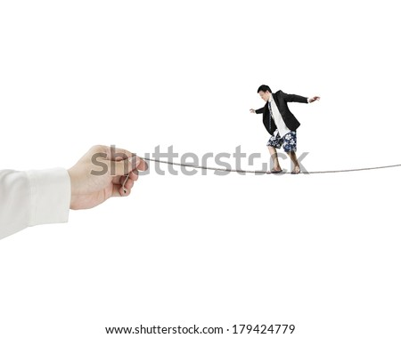 Balancing on rope with hand holding one side - stock photo