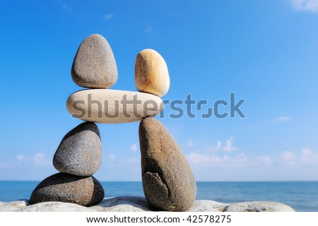 Balancing pebbles in the vertical and horizontal position