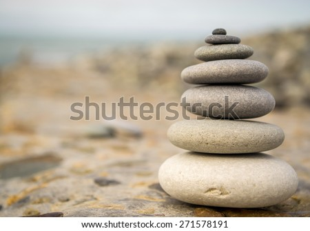 Balancing stones on a rough stone background - stock photo
