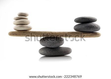 balancing stones on white background - stock photo
