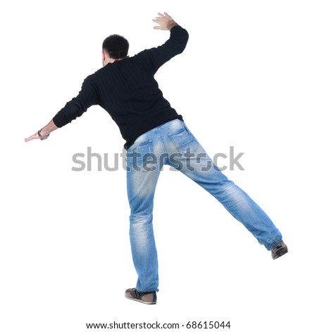 Balancing young man in jacket. Rear view. Isolated over white. - stock photo